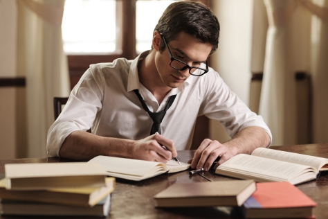 man-writing-books
